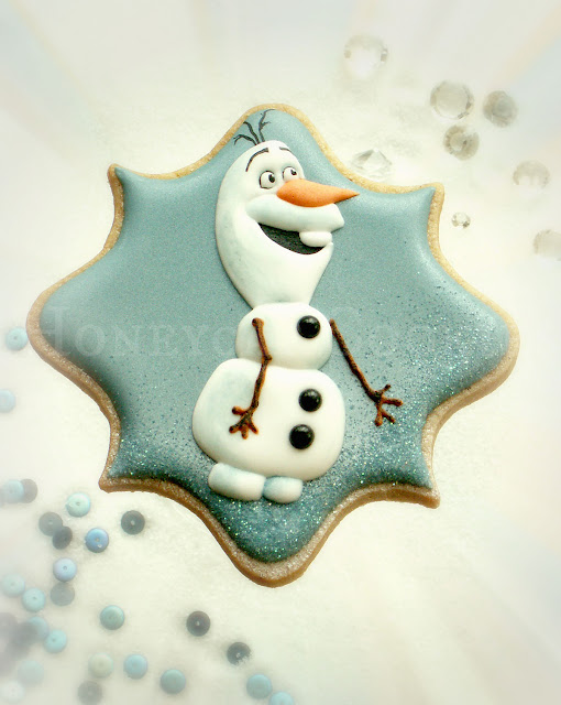 Plaque shaped cookie with whole Olaf in royal icing, cookie and photo by Honeycat Cookies