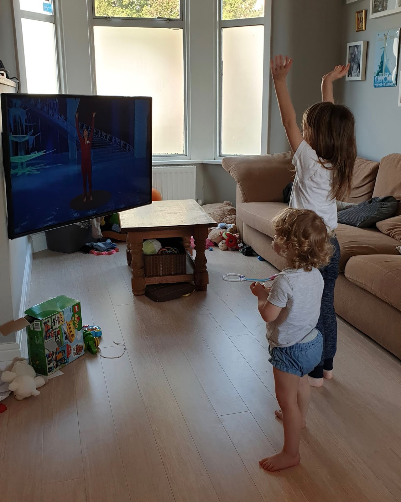 two kids doing home exercise