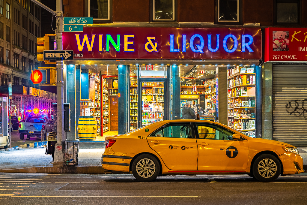 a photo of a taxi in front of a liquor store in new york city daniel south photography