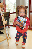 Toddler holding a book about Star Wars Ewoks