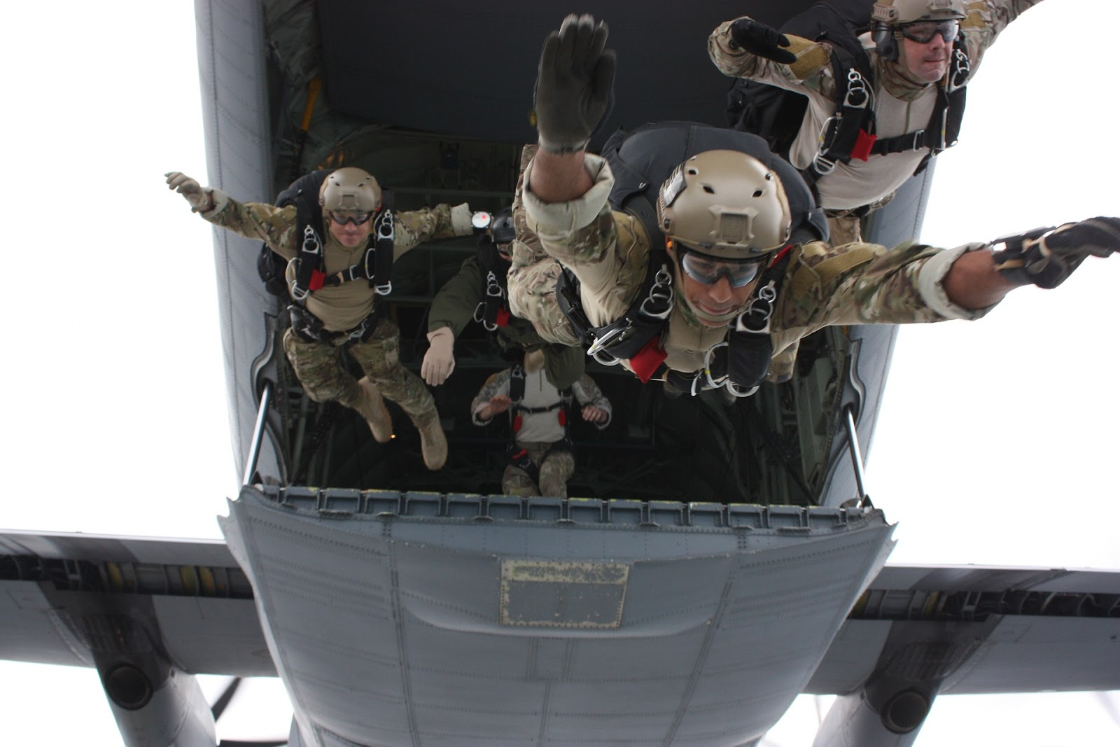 Navy SEALs parachuting out of an airplane to illustrate blog post about navy SEAL training