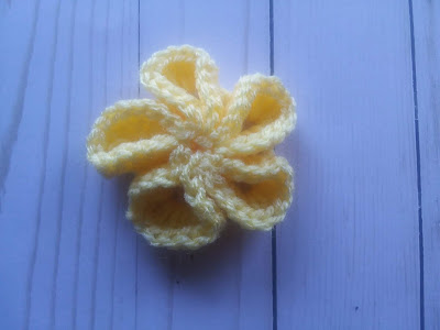 crochet flower in yellow