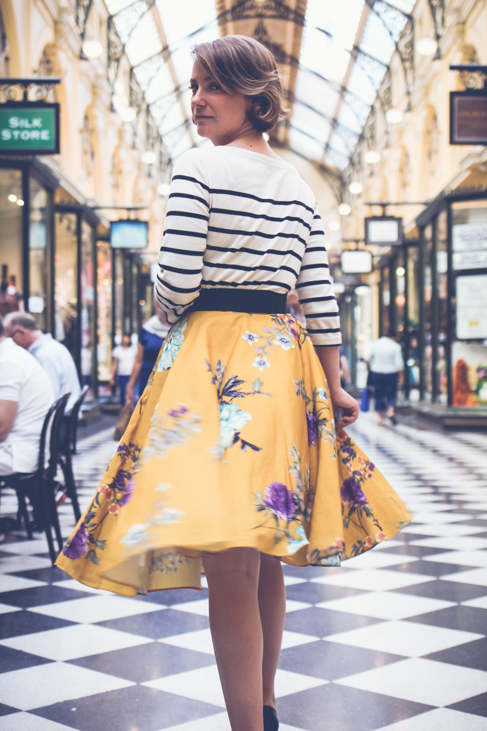 @findingfemme wears black and white striped top with yellow Modcloth floral skirt at the Block Arcade in Melbourne