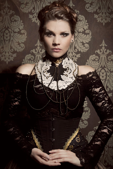 Women's Steampunk clothing inspiration. This woman is wearing a victorian collar necklace with a black lace top and corset.
