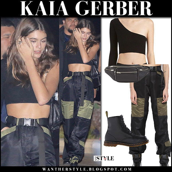 Kaia Gerber in black crop top, black belted pants with pockets and black boots dr. martens model off duty style october 14 2017