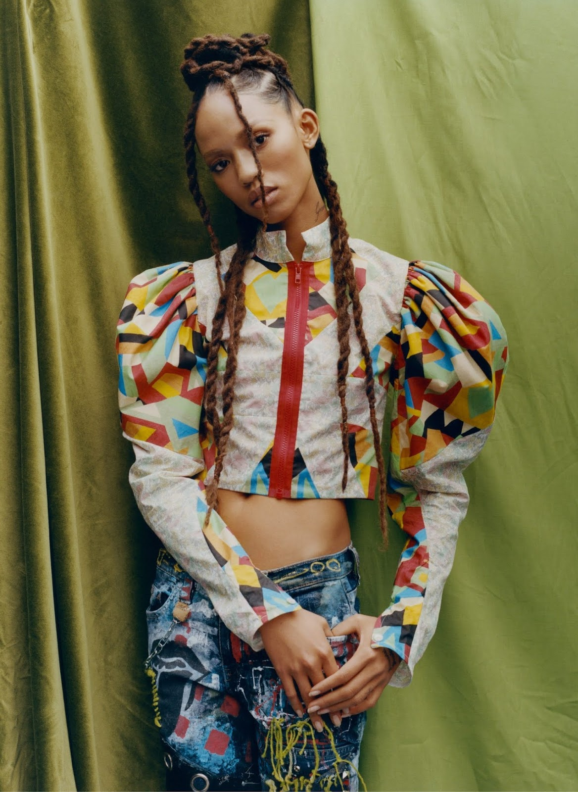 Adesuwa Aighewi poses in Matty Bovan top and Vintage jeans
