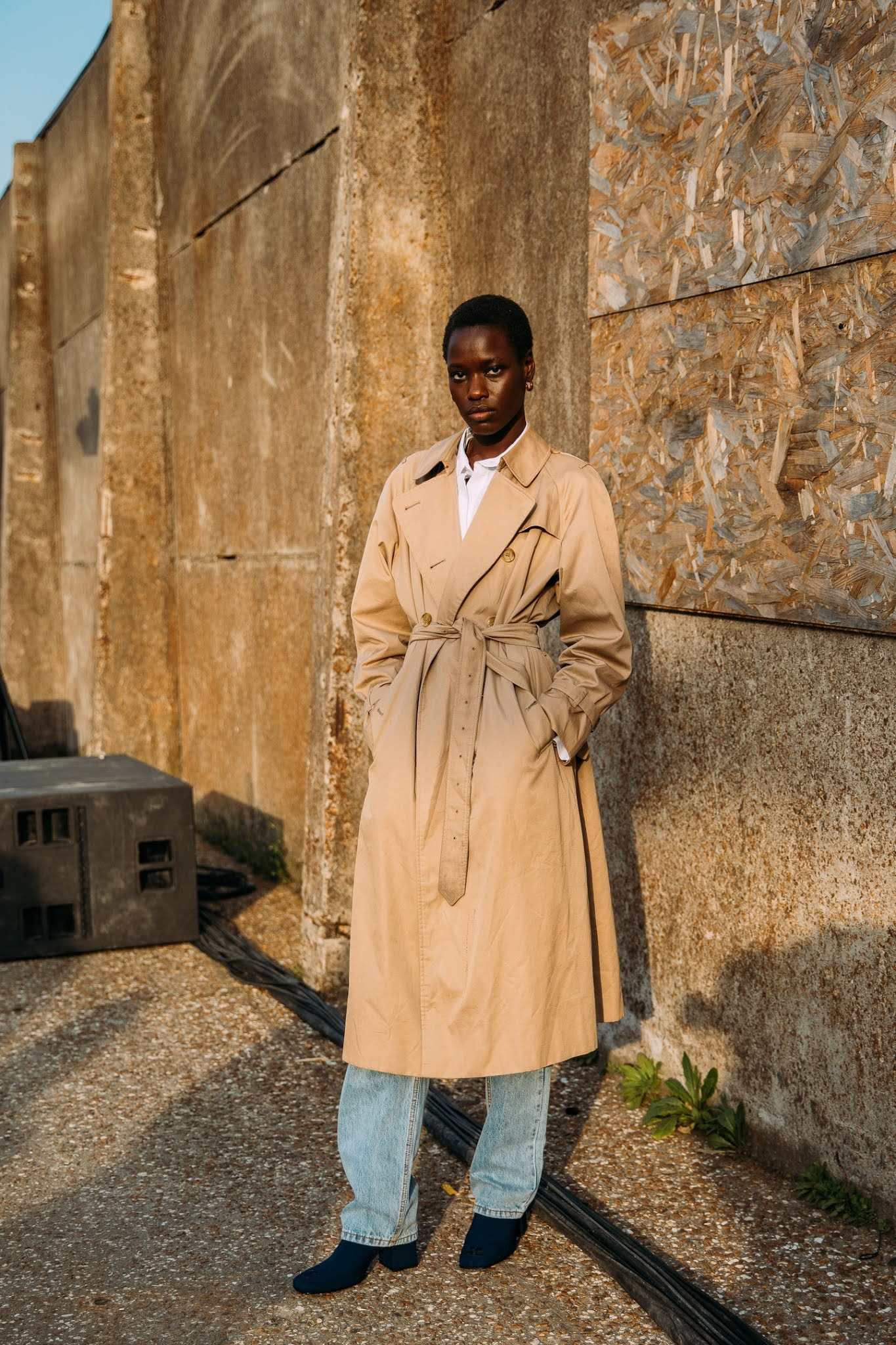 25 Cool Trench Coats I Can't Get Enough of for Spring 2021 — Style Du Monde Model Street Style —Classic Belted Trench, Jeans, and Black Boots