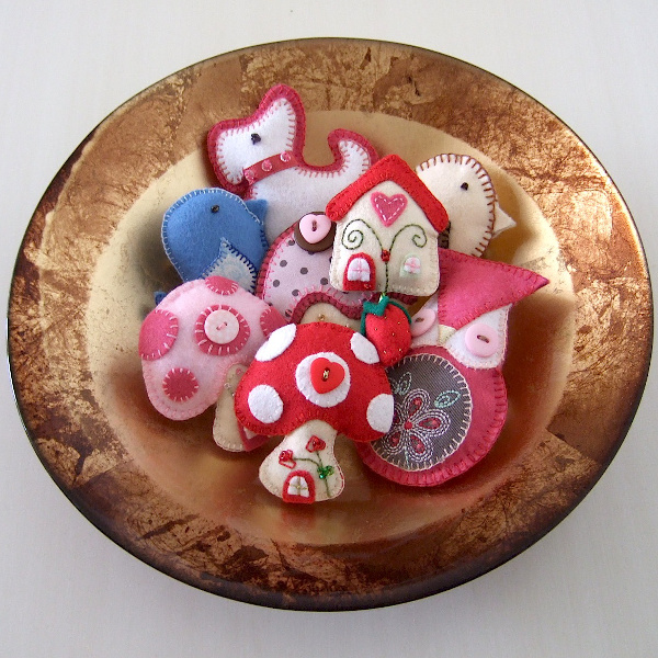 Small felt plush plushies stuffies hand sewn decorations in a bowl craftymarie