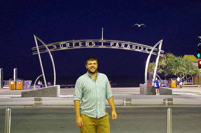 Dan in front of surfers paradise sign at night