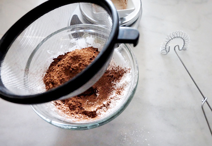 sifting cake flour and cocoa powder