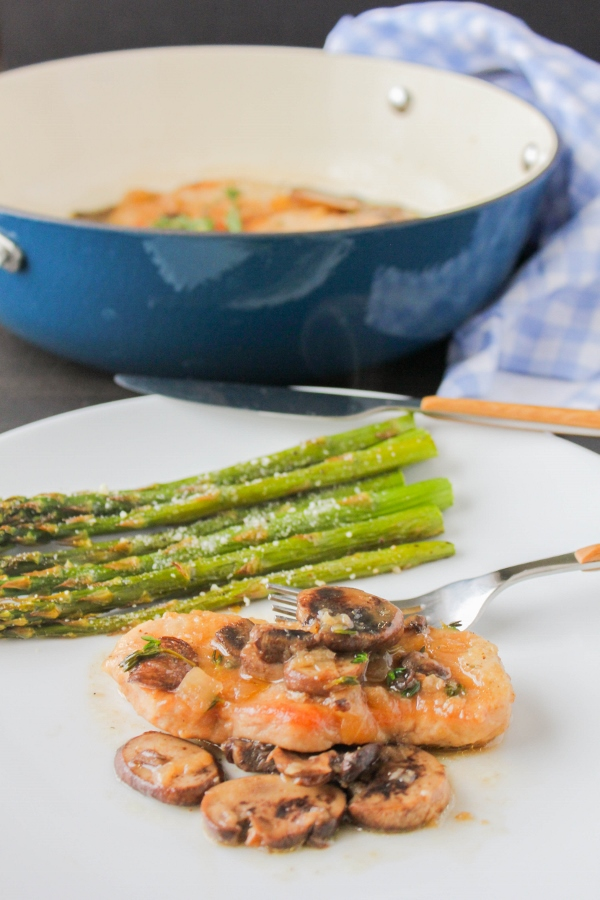 This super simple Skillet Pork Marsala with Roasted Asparagus is a delicious meal that's ready in less than 30 minutes!