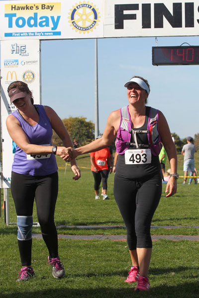 L-R: Jody Larcelet, Hastings, Erena Shing, Havelock North, finish line at Clive - The New Hawke's Bay Today Country2Coast. photograph