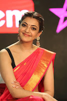 Kajal Aggarwal in Red Saree Sleeveless Black Blouse Choli at Santosham awards 2017 curtain raiser press meet 02.08.2017 076.JPG