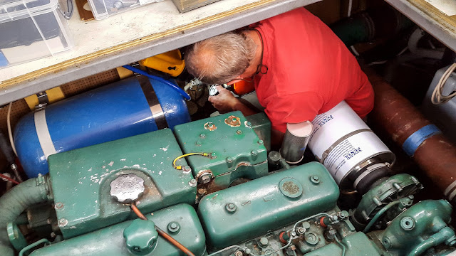 Photo of Phil checking the old water pump in Ravensdale's engine room