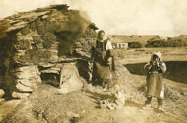 "Mother with children making bread in ""furna"" (owen) - location somewhere near villages Dobroveni and Skochivir"