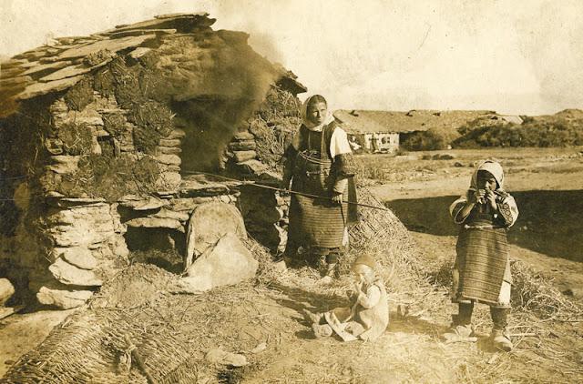 "Mother with children making bread in ""furna"" (owen) - location somewhere near villages Dobroveni and Skochivir"