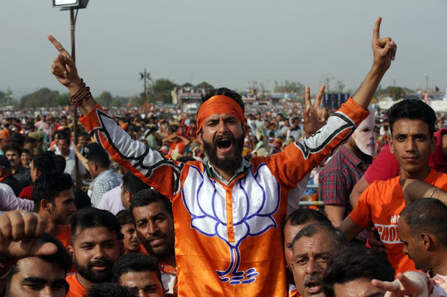Image Attribute: A supporter of Narendra Modi's BJP party at an election rally in late March 2019/Source: Jaipal Singh/EPA