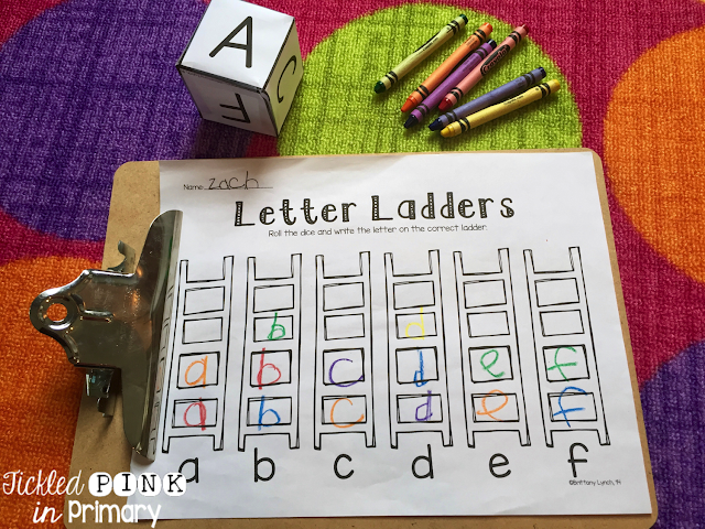 Students practice writing letters based on what they roll. Add crayons to help their fine motor skills.