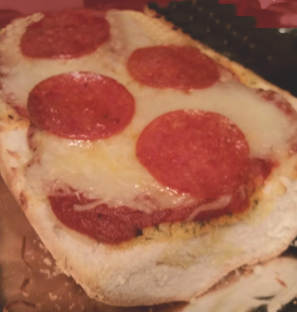 garlic bread topped with pepperoni and cheese