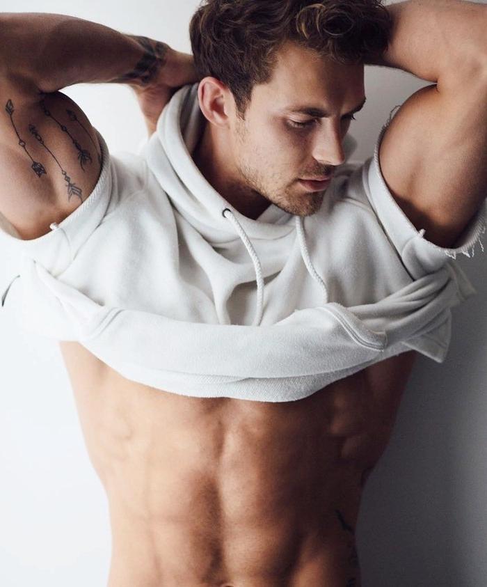 beefy-male-tattoo-model-taking-shirt-off