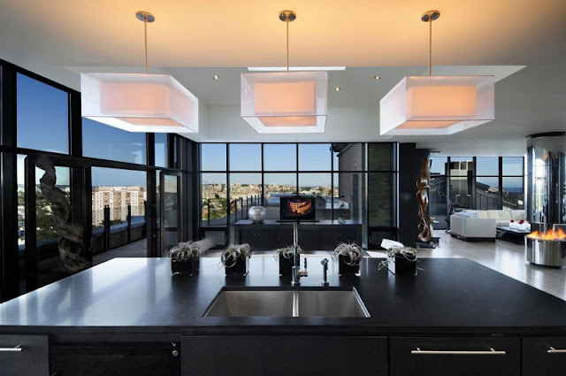 Picture of modern black kitchen island and the movie room behind it