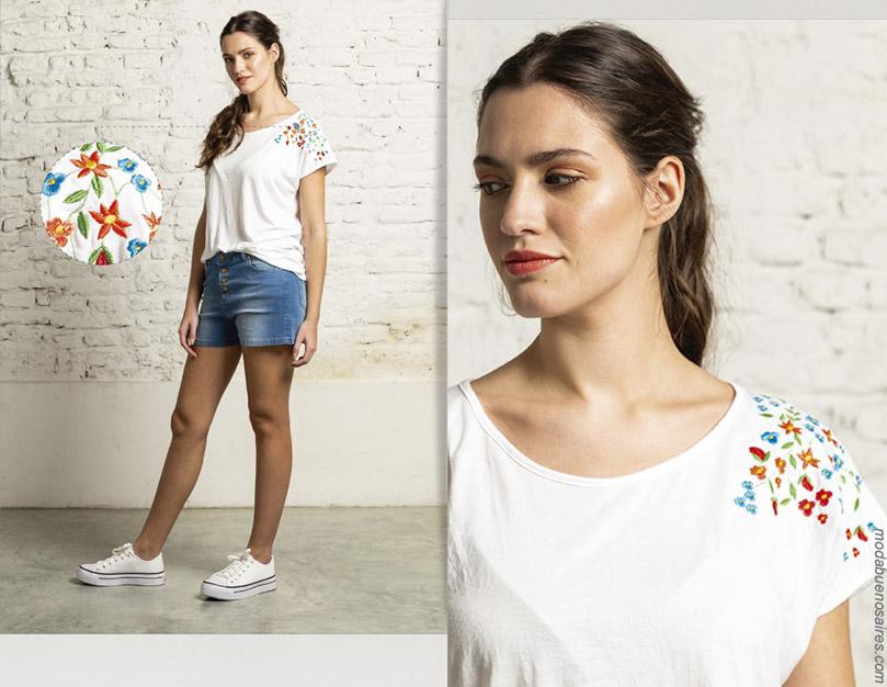 Moda shorts de jeans de mujer con botones.