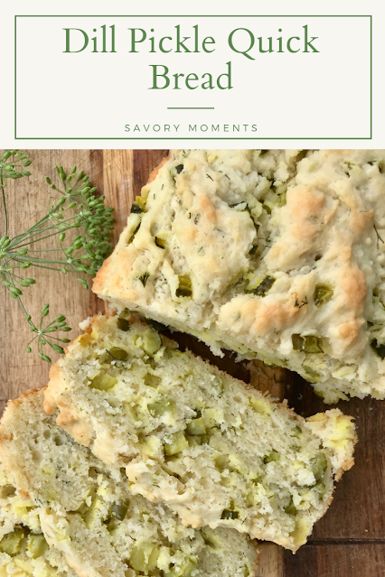 Dill pickle quick bread slices on a cutting board.