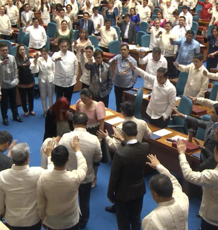 Members of Congress unite to raise hands and pray over Speaker Cayetano