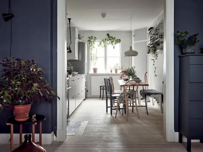 Cocina de estilo nórdico abierta al salón