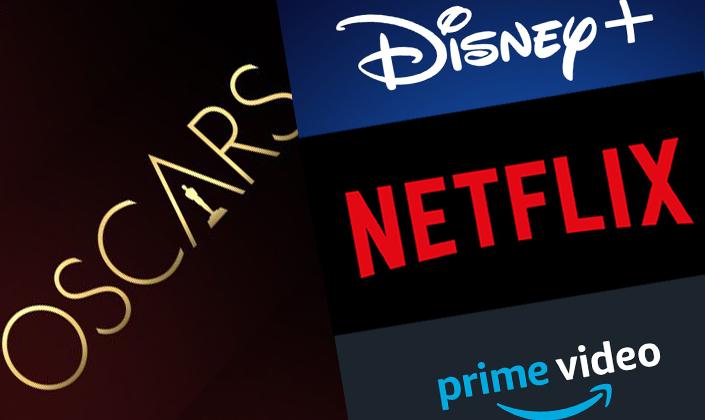 """Montagem com as logos do Oscar, Netflix, Prime Video e Disney+. No lado esquerdo, fundo marrom e a palavra OSCARS em letras maiúsculas douradas na diagonal, e a silhueta da estatueta dentro do A. Na direita superior, Fundo azul escuro. Na parte superior da imagem a cor é mais forte e na inferior é levemente desbotada. No centro a logo da Disney em branco com o arco da magia em azul que termina no símbolo de +, também em branco. Abaixo, Fundo preto com a palavra """"Netflix"""" escrita em vermelho no centro. E por último, mais abaixo, Fundo cinza escuro. No centro a palavra """"prime"""" em azul e """"video"""" em branco, e abaixo uma seta azul arredondada indo da direção de """"prime"""" para """"video""""."""