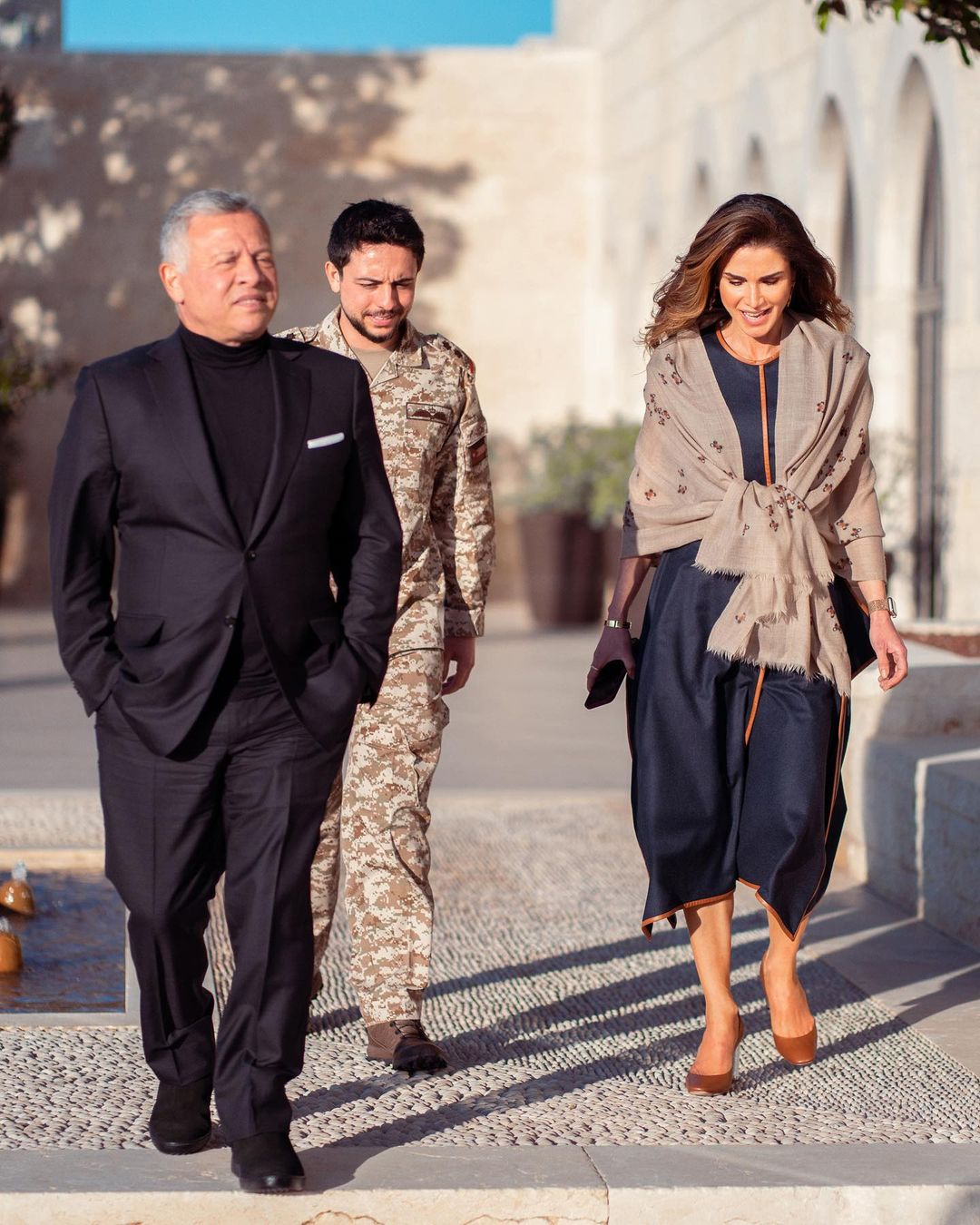 Queen Rania of Jordan stepped out for a walk around the Palace wearing a Stella McCartney Dress