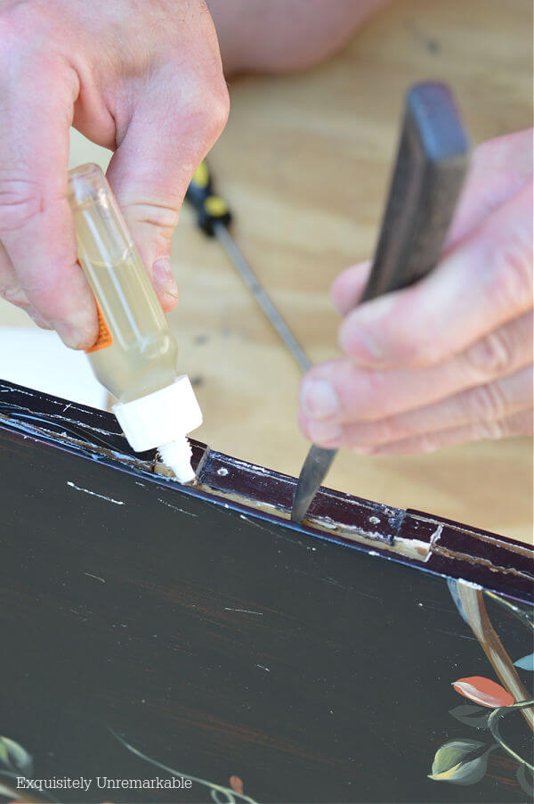 Repairing A Fireplace Screen with glue