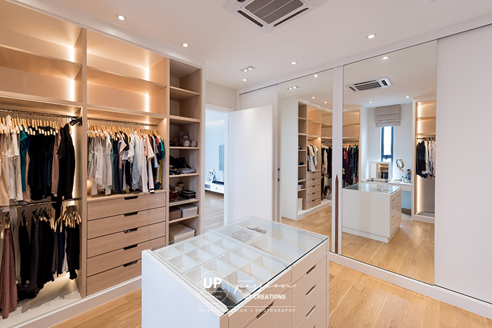 ss1 bungalow master open style walk in wardrobe in a color combination of white and wood with custom made accessories island and full height mirror at closed up wardrobe