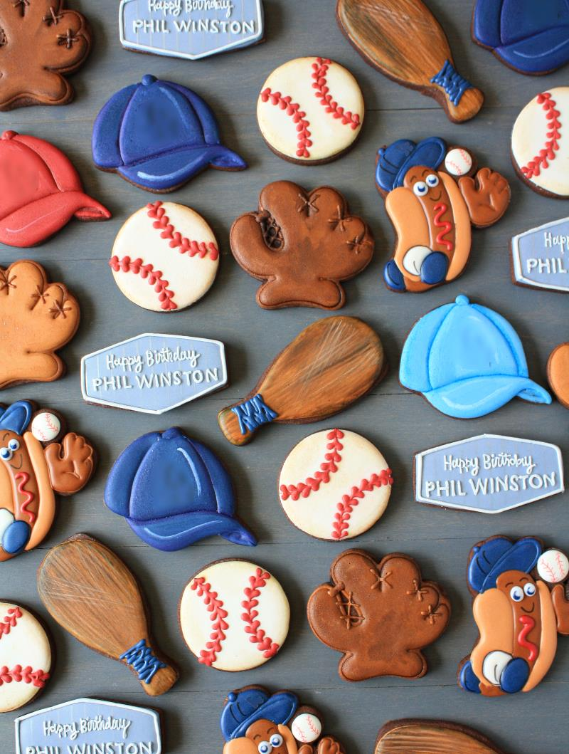 red and blue decorated baseball chocolate sugar cookies for a birthday