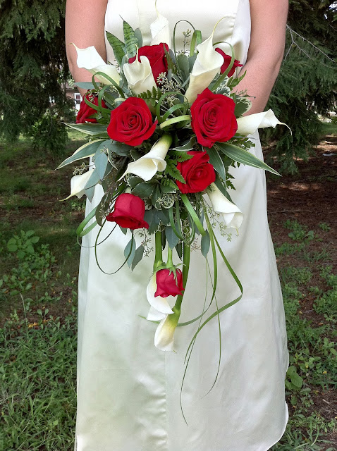 Red rose and calla lily cascading bridal bouquet by Stein Your Florist Co.
