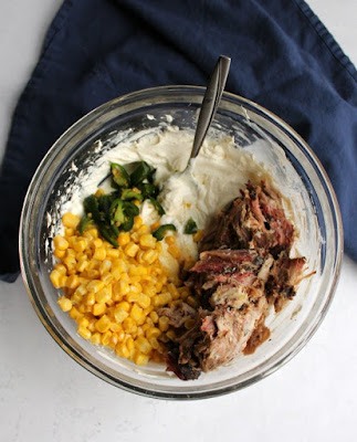 mixing bowl filled with creamy pulled pork dip ingredients