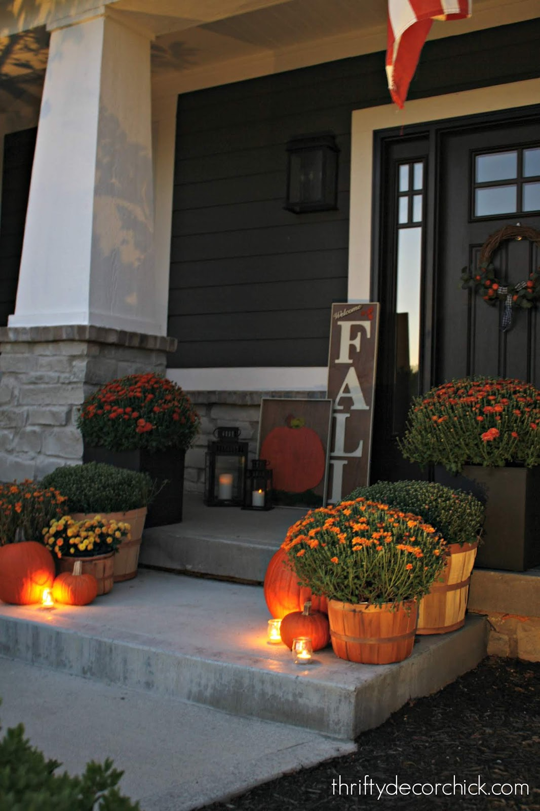 Fall porch with mums and pumpkins