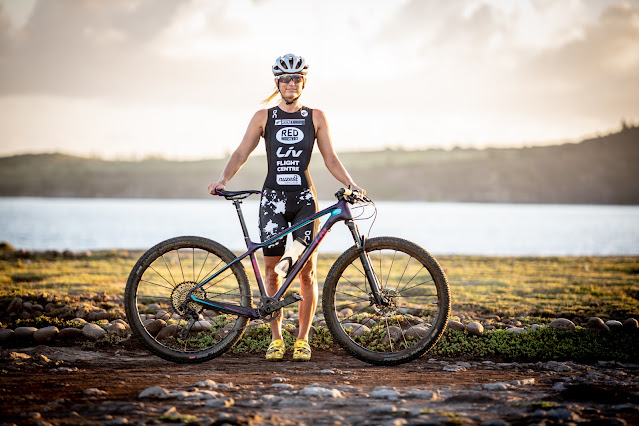 Triathlete and Xterra competitor Jacqui Slack with everything she needs: something to swim in, something to ride and something to run on.
