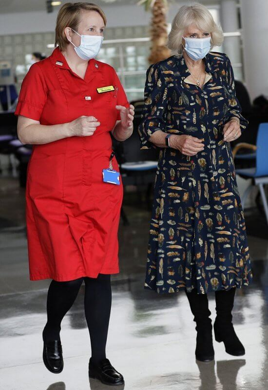 The Duchess of Cornwall wore a navy blue shirt dress with feather print detail