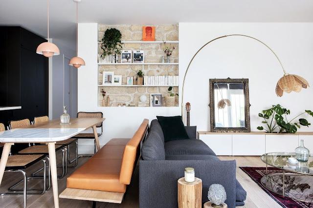 Un mini-loft parigino rivisita lo stile industriale ottimizzando gli spazi