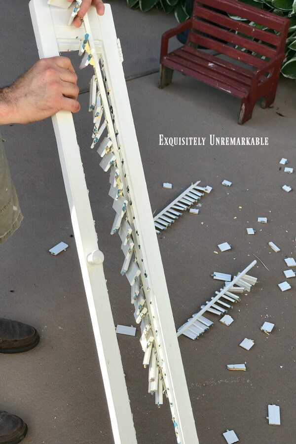 Removing Slats From Shutters by hand after cutting them apart