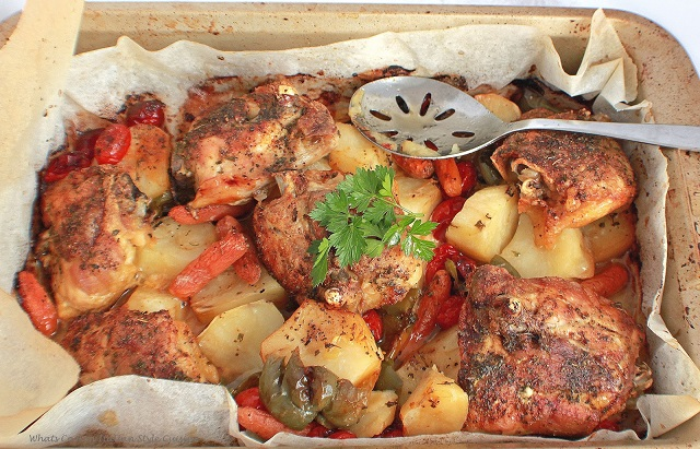 Italian  baked chicken with potatoes, carrots, peppers and tomatoes baked in the oven until crispy