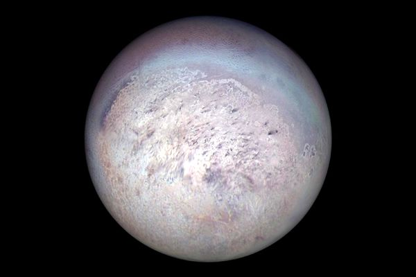 An image of Neptune's moon Triton that was taken by NASA's Voyager 2 spacecraft in August of 1989.