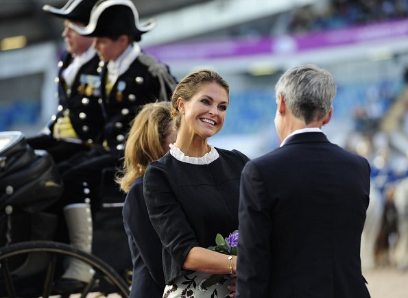 Princess Madeleine wears Alberta Ferretti Pleated Neck Wool Blend Jacket and Baum Und Pfergarten Sashenka Floral Midi Skirt
