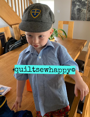 Little Mr L trying on his new school uniform