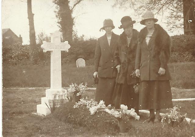Three ladies at grave side