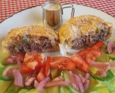 Cheeseburger Wellington Cut Open with Burger Topping Salad