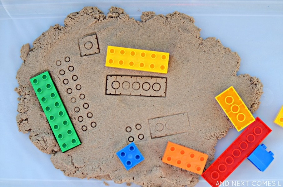 Fine motor activity for kids: stamping LEGO in kinetic sand from And Next Comes L