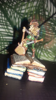 Dally the Party Bard, on a stack of books, from behind (omg, that bubble butt!)