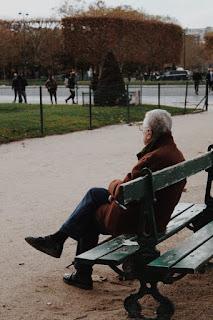 elderly-man-sitting-on-bench